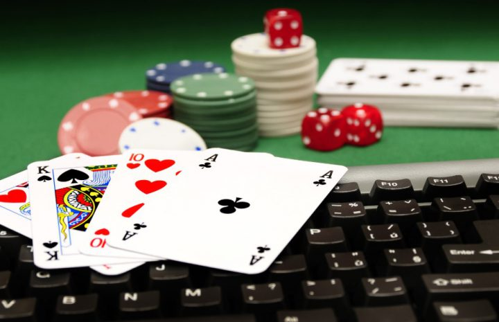 Casino chips and cards on keyboard
